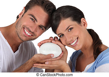 Couple holding bar of soap