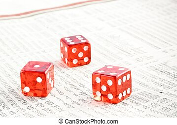 three red dice on the financial newspaper