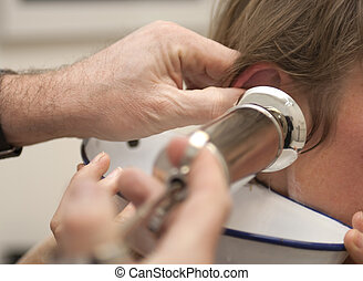 Cleaning ear with syringe - Doctor with big syringe ready to...