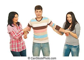 Surprised man between two women - Surprised man between two...