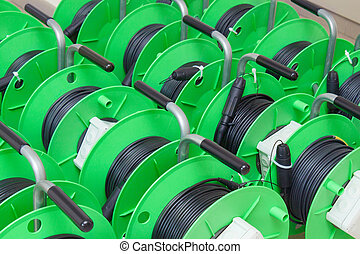Group of cable reels for new fiber optic installation -...