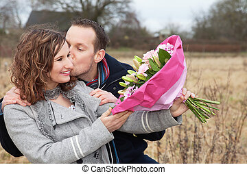 Couple In Love - Loving man kissing woman while holding...