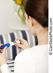 Bruentte woman with pregnancy test - Bruenette woman with...