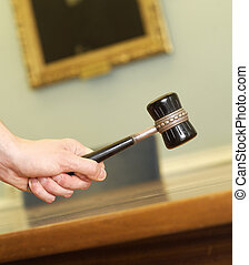 Judgement - Hand Holding a Mallet on a table