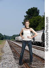 Beautiful Teenage Woman on Railroad Tracks - Young Beautiful...