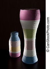 Yarn wrapped glass bottles - Two yarn wrapped colorful...