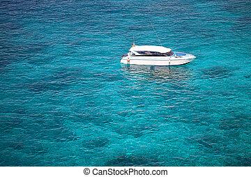 Boat in coral sea