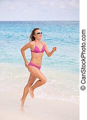 Jogging on White Sandy Beach