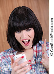 brunette shouting angrily at phone