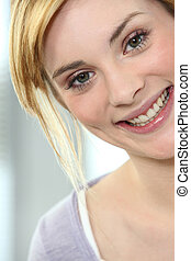 Portrait of a young blond woman cheerful