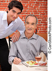 Grandfather with grandson at restaurant
