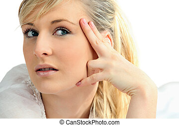 Portrait of young woman pensive