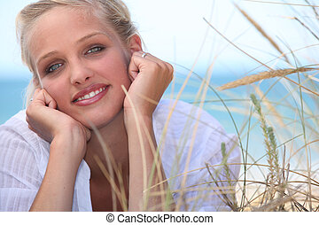 Attractive blond, laid on the beach
