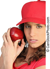 Woman in red with a red apple