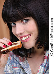 Woman eating a slice of marble cake
