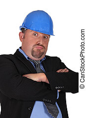 Disapproving businessman in a hardhat