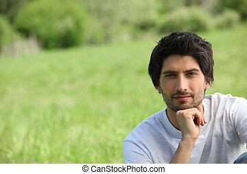 Man sat in field