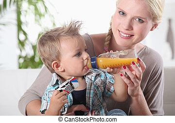 portrait of a woman feeding her son