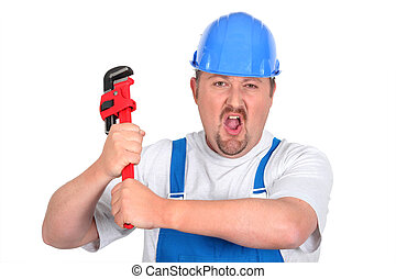 Workman in dungarees with wrench - Workman in dungarees with...
