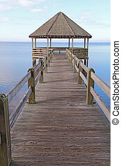 Gazebo and dock over calm sound waters vertical