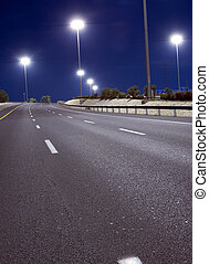 Empty highway at night without people and cars