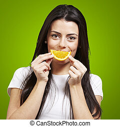 woman with an orange smile - woman with an orange slice as a...
