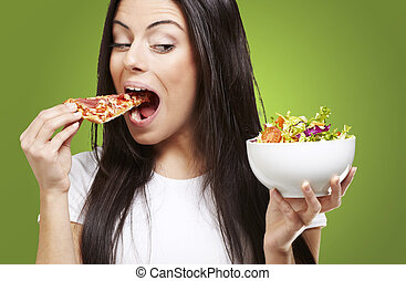 woman eating pizza - woman choosing a slice of pizza instead...