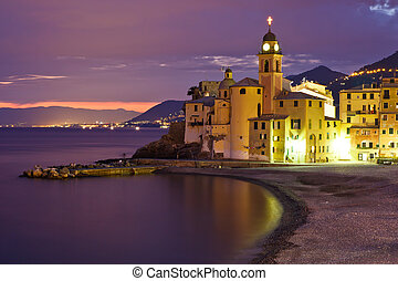 Beautiful Sunset on the Pebble Beach in Camogli near Genoa,...