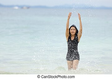 thai woman playing in sea