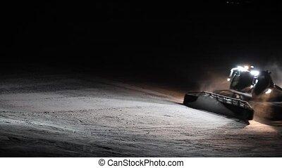 Snowcat preparing ski slope - Snow-cat preparation of ski...