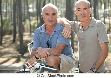 portrait of two friends on bikes