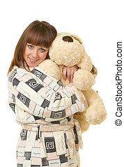 Beautiful young girl with toy dog