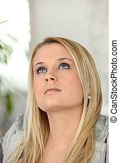 Portrait of a blond woman pensive