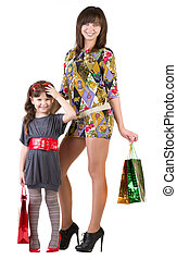 Happy mother and little girl with shopping bags isolated