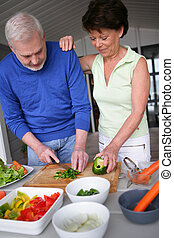 Older couple preparing a meal