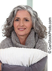 mature grey-haired woman smiling