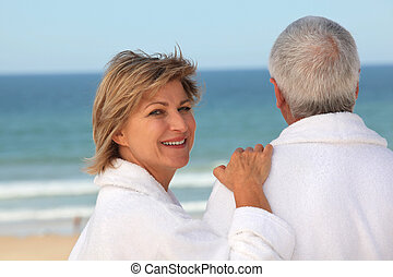 Older couple outdoors in bathrobes