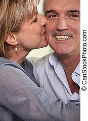 Adult couple kissing