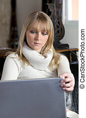Woman looking at her laptop at home