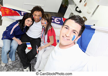 A group of friends supporting the French football team