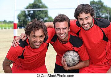 Three football team mates