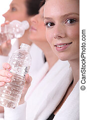 Women drinking water after a workout