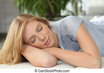 Blonde girl napping on couch