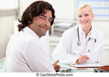 man chatting with a nurse