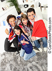group of French football fans celebrating