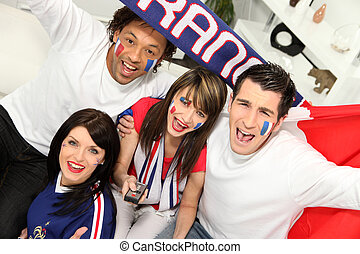 Young people supporting French sports team
