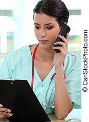 Female medic making a telephone call