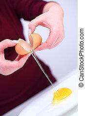 Cracking an egg  - Woman cracking an egg