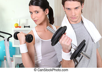 Couple using hand weights