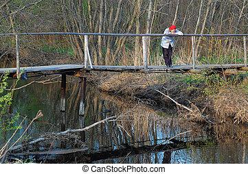 Sad Woman on Wooden Bridge in the Late Fall